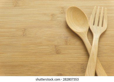 wood  spoon and fork on wood background