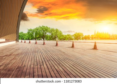 Wood square floor and green forest natural landscape at sunset