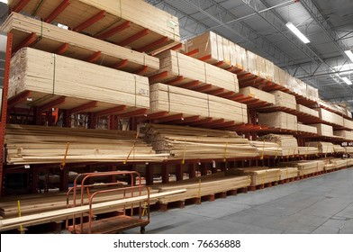 Wood stacked on shelving inside a lumber yard