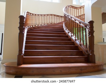 the wood stair is interior in the building  this is a luxury style.