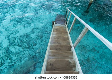 wood stair into the sea