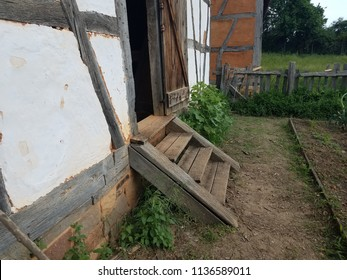 wood stairs or steps and old building with garden