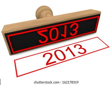 a wood stamp with red lettering 2013
