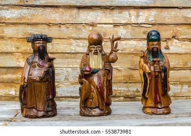Wood Statue of Chinese Gods,  of Fortune (Fu,Hok),  of Prosperity (Lu,Lok), and  of Longevity (Shou,Siu), Select Focus.