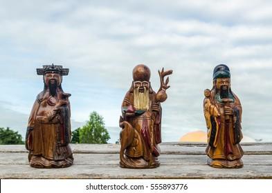 Wood Statue of Chinese Gods,  of Fortune (Fu,Hok),  of Prosperity (Lu,Lok), and  of Longevity (Shou,Siu), Select Focus. (Public)