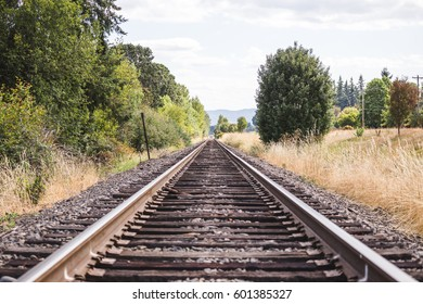 Wood and steel train tracks in a rural area of Oregon, USA.