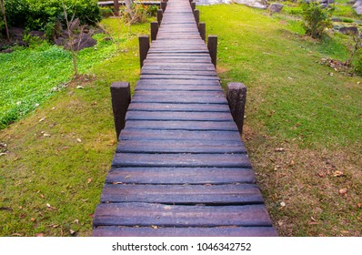 Wood and stone walkways, walkways and rock gardens, pathways with natural trees.