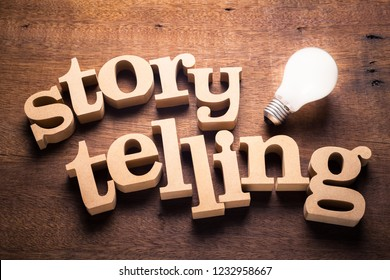 Wood Storytelling word with glowing light bulb. Storytelling idea