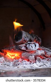A wood stove-heating, burning some wood very slowly