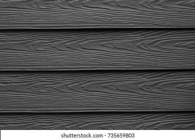 Wood substitute board and high quality fiber cement board texture for architect, Black wood texture and background, Wood plank with patterns for design and cement striped wood wall