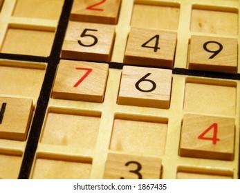 Wood sudoku board and tiles.
