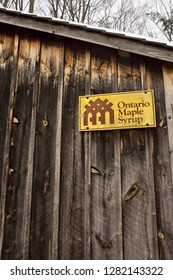 Wood sugar shack with the Ontario Maple Syrup Producers Association sign Kortright Centre for Conservation,  Woodbridge, Ontario, Canada - March 1, 2015