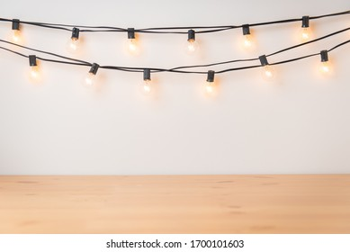Wood surface copy space and string lights background