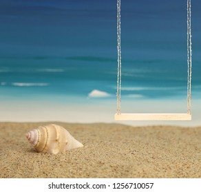A wood swing at the beach with sand, a seashell, and the ocean in the background.  A portrait background backdrop for children.