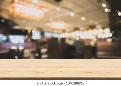 wood table with abstract blurred cafe restaurant with bokeh lights defocused background
