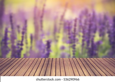 Wood table andlavender flower Blurred background can be used for display or montage your products.Vintage color