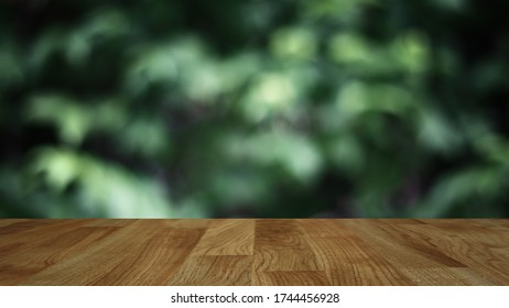 wood table background with abstract blurred soft light fresh green nature background, mock up for green eco environmental friendly product display.