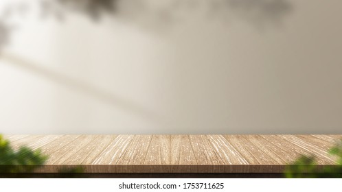 wood table background with sunlight window create leaf shadow on wall with blur indoor green plant foreground.panoramic banner mockup for display of product,warm tone lights - Shutterstock ID 1753711625