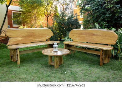 wood table and benchs in the garden at sunny day