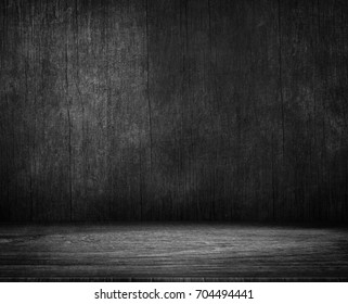 Wood table and black concrete wall background. To display montages Product