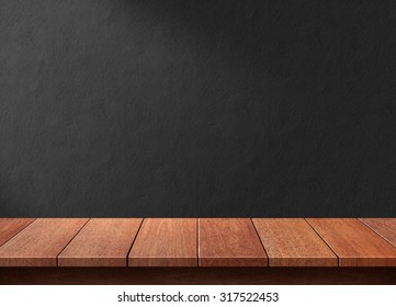 Wood table with black wall background