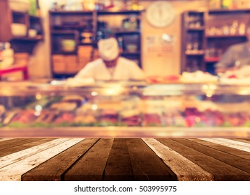 wood table and blur image of sushi counter in vintage style decoration restaurant.