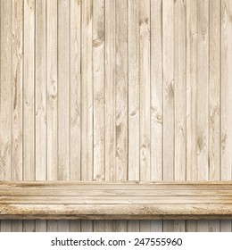 Wood table and bright wooden wall background