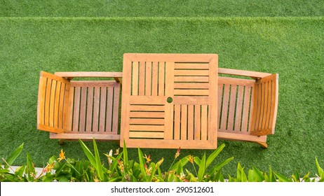 wood table and chair table on grass
