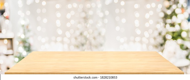 Wood table with Christmas decor in living room blur background with bokeh light,Holiday backdrop,Mockup banner for display of advertise product ,luxury house.