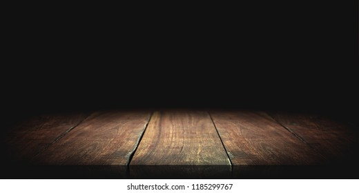 Wood table in the dark background.
