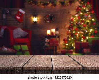 Wood table in front of christmas tree light with bokeh & blur effect