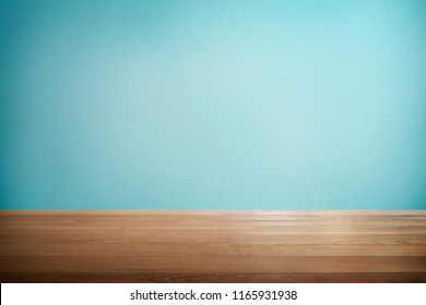 Wood table with mint blue background .