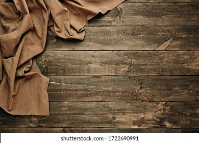 Wood table with old sackcloth burlap tablecloth texture with filter effect retro vintage style. Flat lay. Copy space, maintenance concept. Top view.