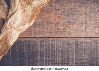 Wood table with old sackcloth burlap tablecloth texture with filter effect retro vintage style