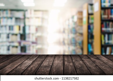 wood table on blur background modern library background can be used for display or montague your products.Mock up for display of product.
