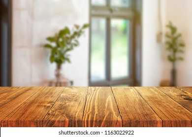 wood table on blur background in the cafe or coffee shop - can used for display or montage your products