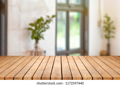wood table on blur background in the cafe or coffee shop background with bokeh image - can use for display or montage your products