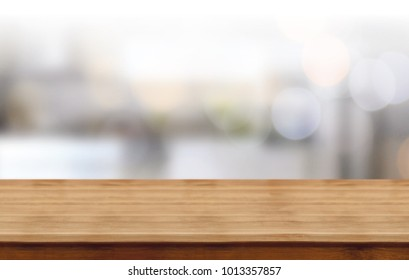 wood table on blur of cafe, coffee shop, bar, background