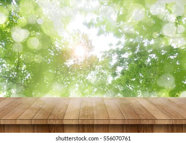 Wood table perspective with green leaf