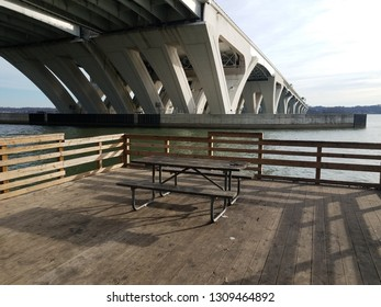 wood table and pier with Wilson bridge and Potomac river