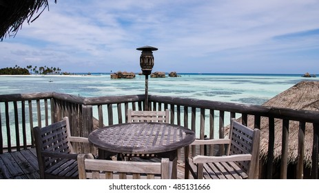 wood table set Over water Villa tropical  resort Maldives blue sky and green sea 16:9 scale background concept color processing