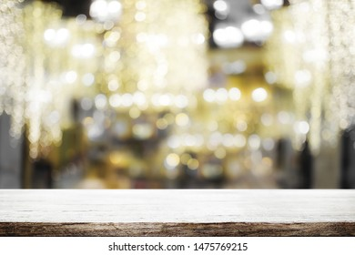 Wood table space and blurred bokeh light of coffee shop background. product display template. Business presentation.
