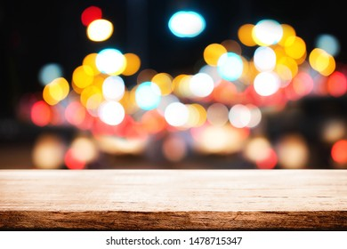 Wood table space and blurred night light bokeh background. product display template.