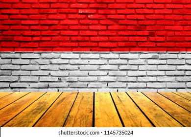 Wood Table Texture with Indonesia Flag painted on brick Wall Background. For Display Product and Montage.