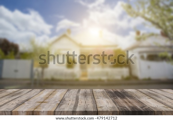 Wood table top (as house) on blur house background - can be used for display or montage your products