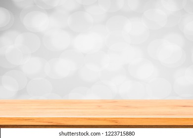 Wood  table top with  black and white blurred  bokeh background, can be used for montage or display your products
