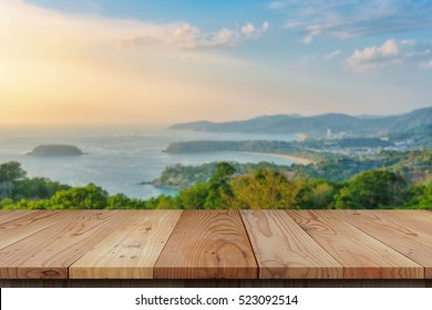 wood table top and blue sky with seascape background