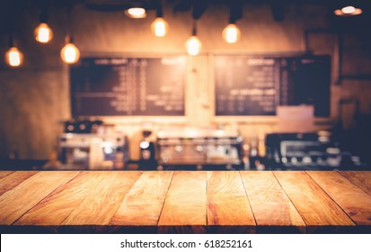Wood table top with blur counter coffee shop,cafe background.For montage product display or design key visual layout