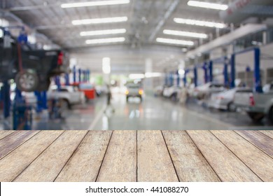 Wood table top with blur garage background, for montage product display