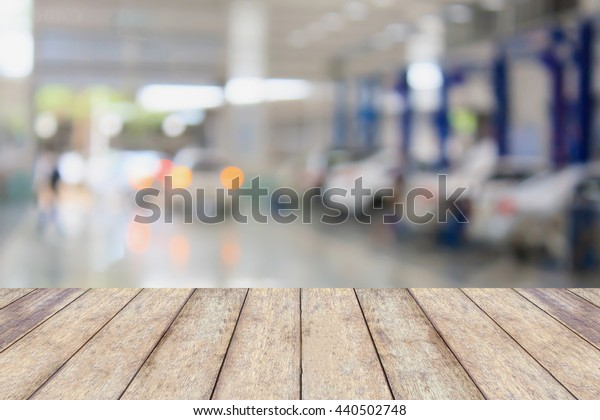 Wood table top with blur garage background, for product display